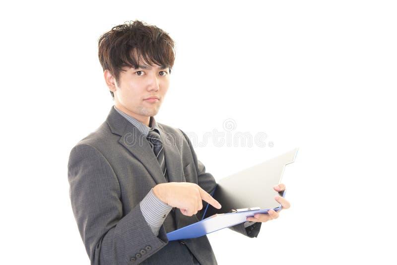 Hombre de negocios asiático difícil imagen de archivo libre de regalías