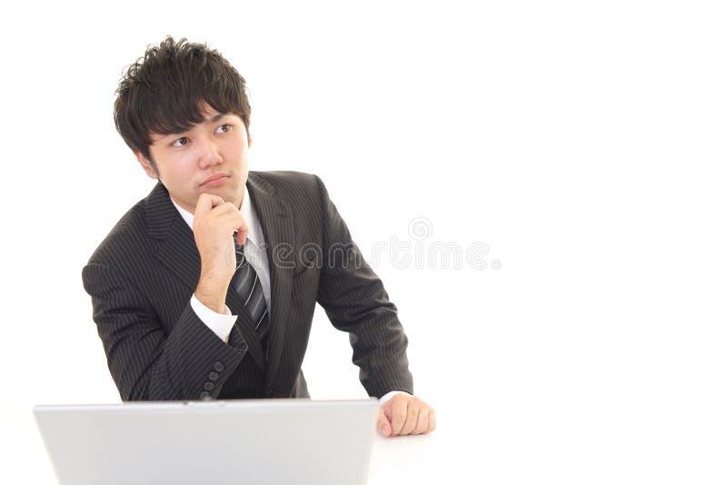 Hombre de negocios asiático difícil imágenes de archivo libres de regalías