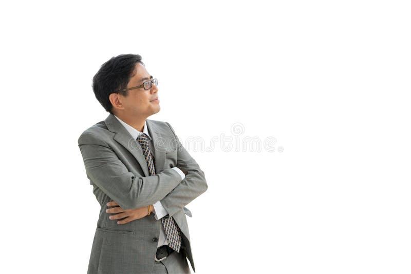 Hombre de negocios asiático mayor en un fondo blanco aislado, mucho copyspace foto de archivo