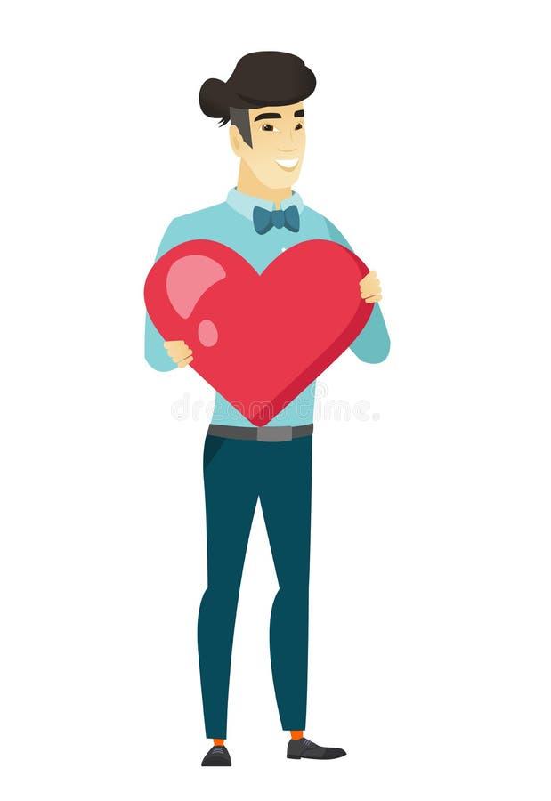 Hombre de negocios asiático que lleva a cabo un corazón rojo grande libre illustration