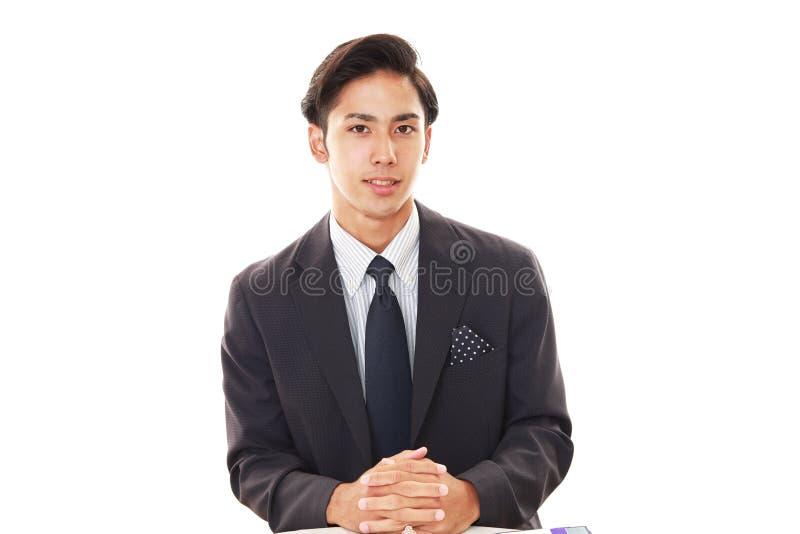 Hombre de negocios asiático sonriente fotos de archivo libres de regalías