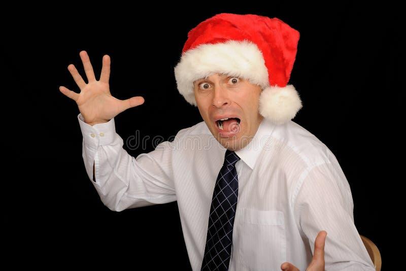 Hombre de negocios asustadizo de la Navidad foto de archivo libre de regalías