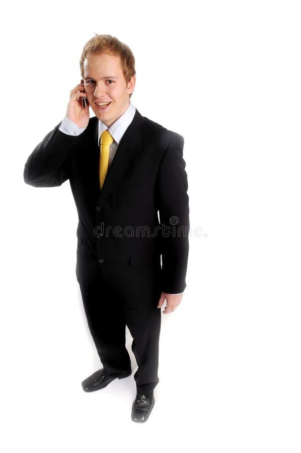 Hombre de negocios atractivo en juego oscuro fotografía de archivo