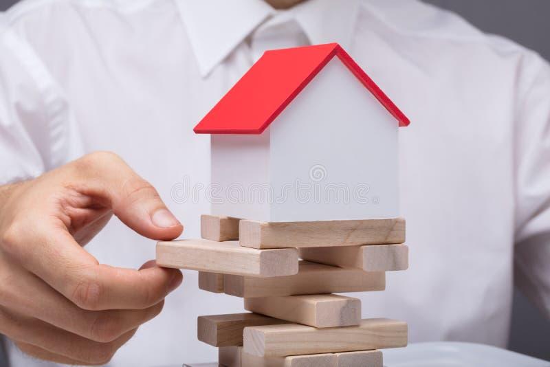 Hombre de negocios Balancing Property Sector imagen de archivo libre de regalías