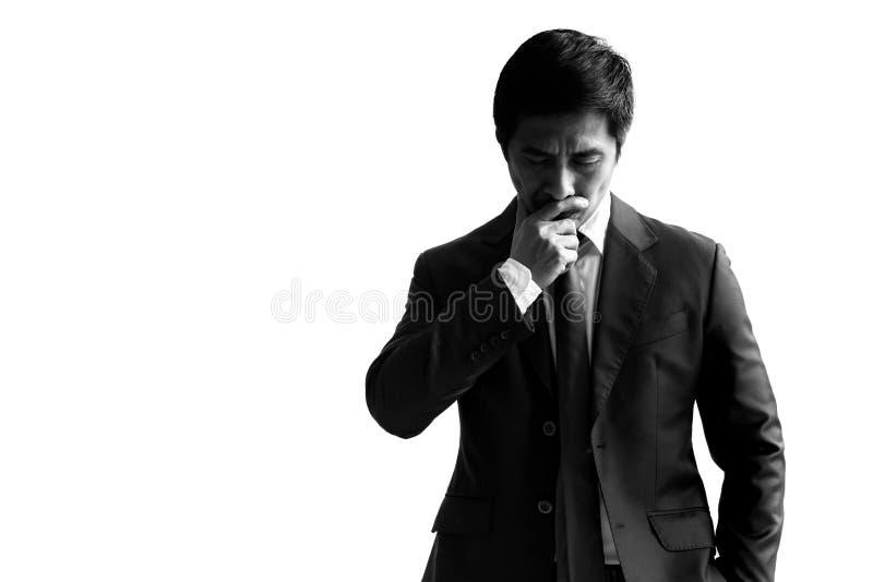 Hombre de negocios blanco y negro del alto contraste en una mano del traje en el suyo imagen de archivo