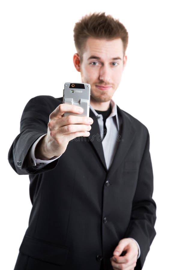 Hombre de negocios caucásico que toma el cuadro fotografía de archivo libre de regalías
