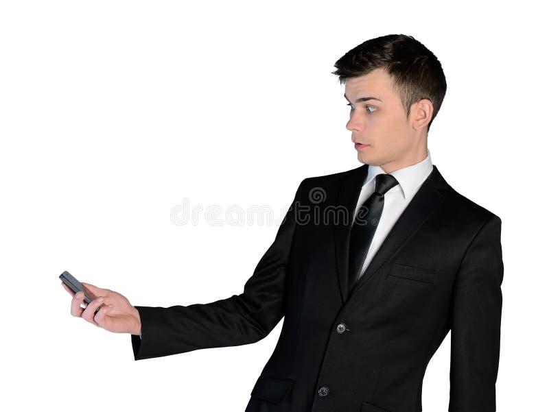 Hombre de negocios chocado con el teléfono foto de archivo libre de regalías