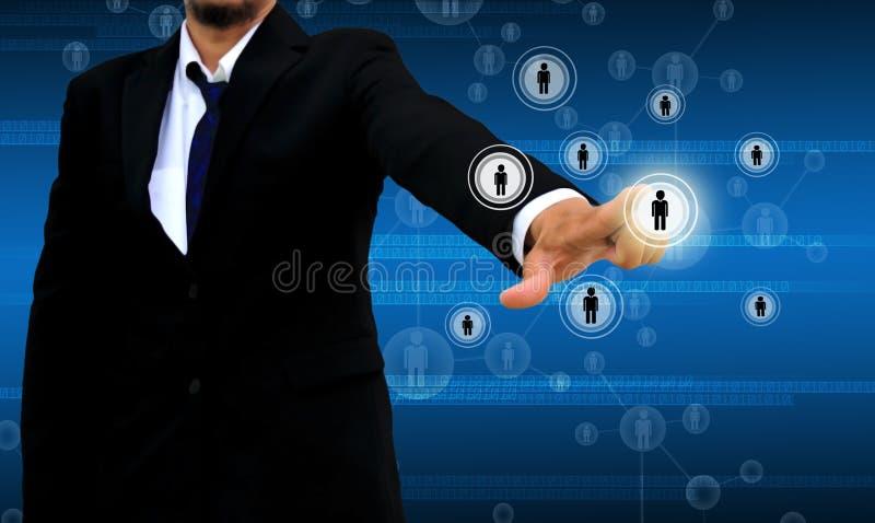 Hombre de negocios Choosing la persona adecuada imagenes de archivo