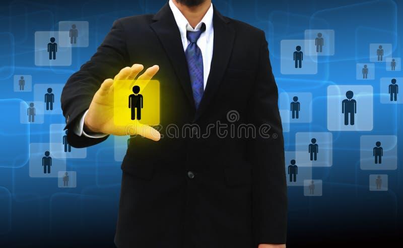 Hombre de negocios Choosing la persona adecuada fotografía de archivo