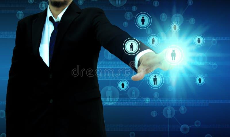 Hombre de negocios Choosing la persona adecuada fotos de archivo