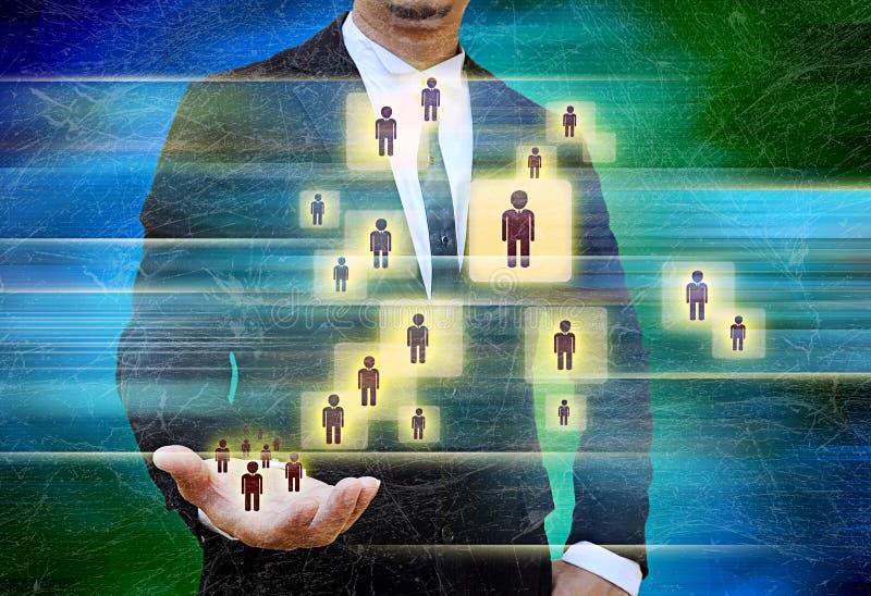 Hombre de negocios Choosing la persona adecuada imagen de archivo