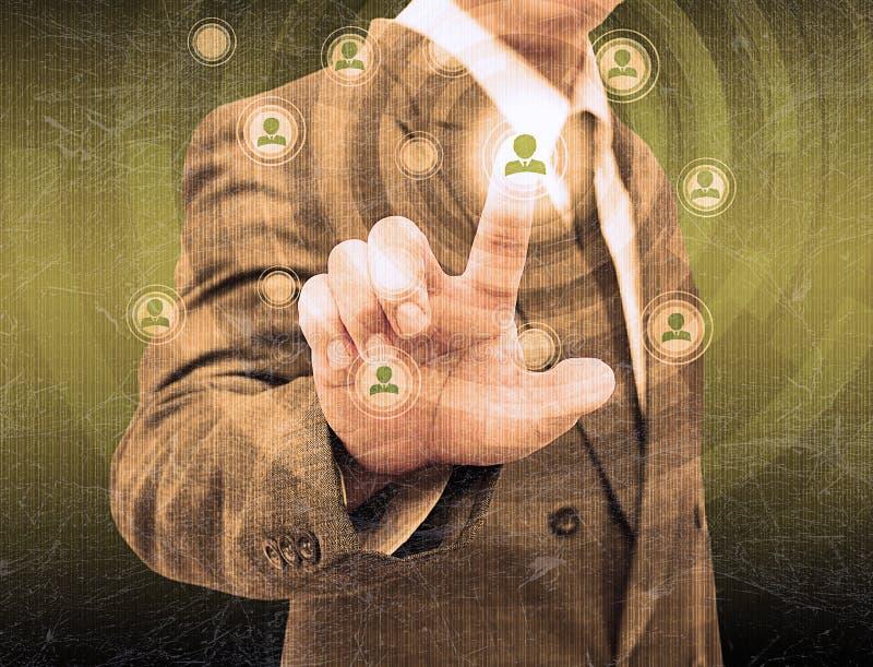 Hombre de negocios Choosing la persona adecuada en la vieja textura fotografía de archivo libre de regalías