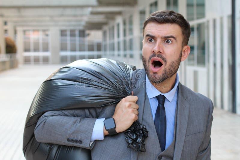 Hombre de negocios cogido en fragante mientras que roba el dinero fotos de archivo libres de regalías