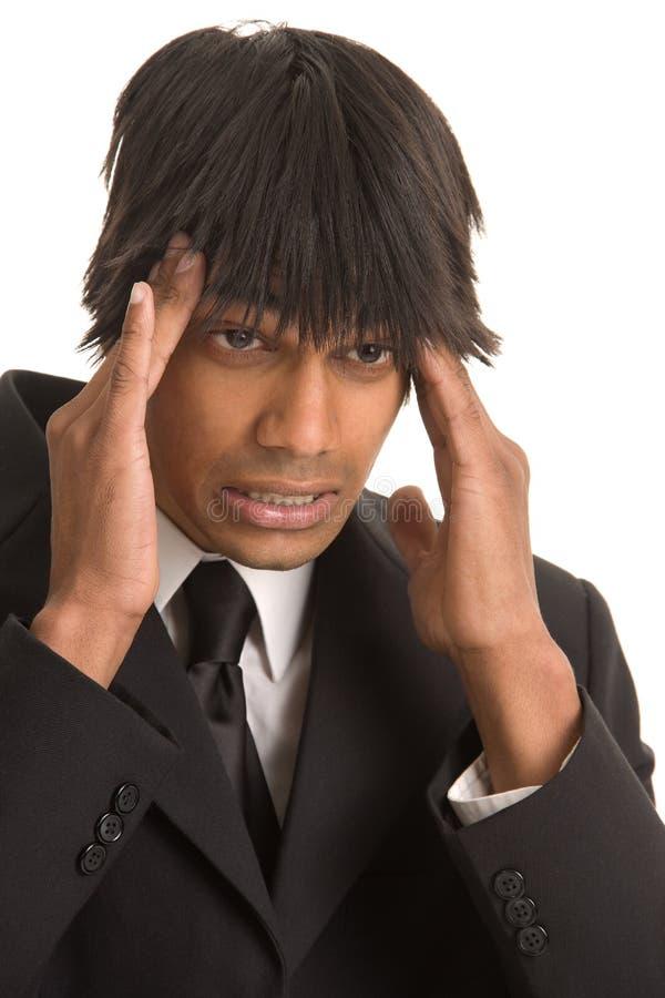 Hombre de negocios con dolor de cabeza imágenes de archivo libres de regalías
