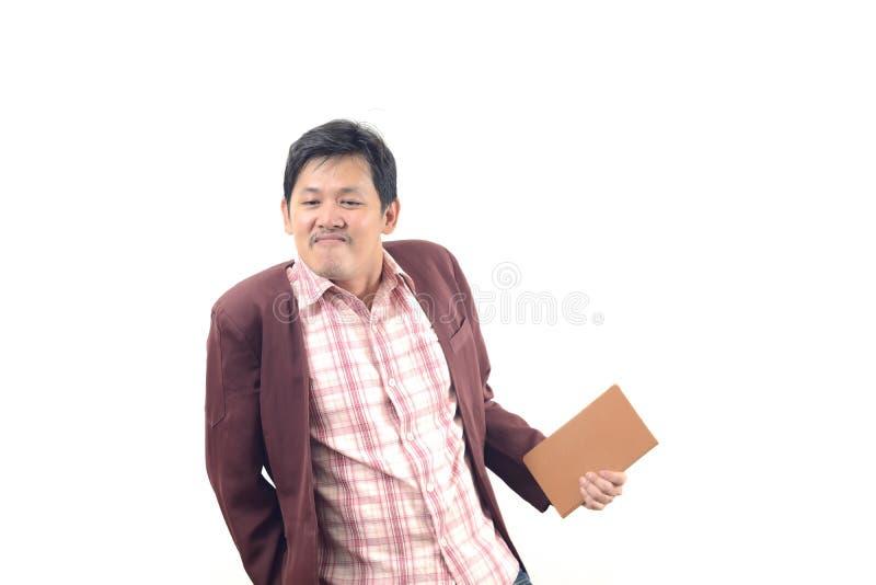 Hombre de negocios con el aislante burlón de la cara en el fondo blanco imagenes de archivo