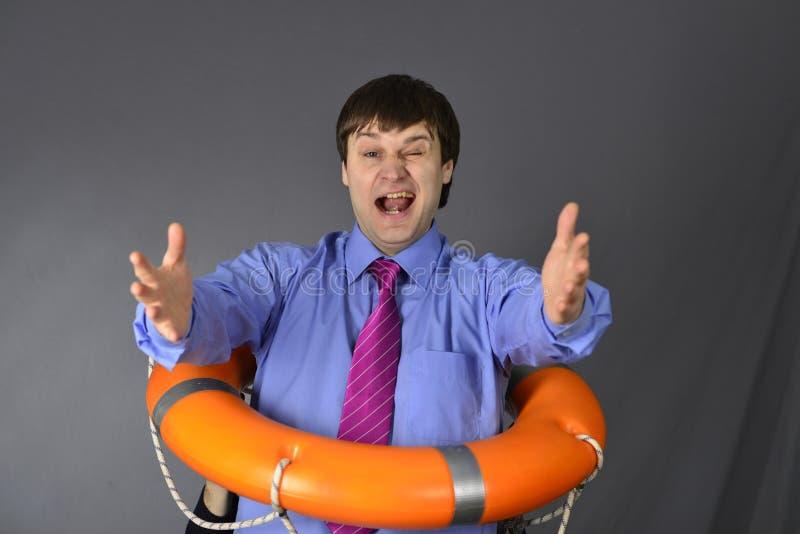 Hombre de negocios con el anillo del salvavidas fotos de archivo