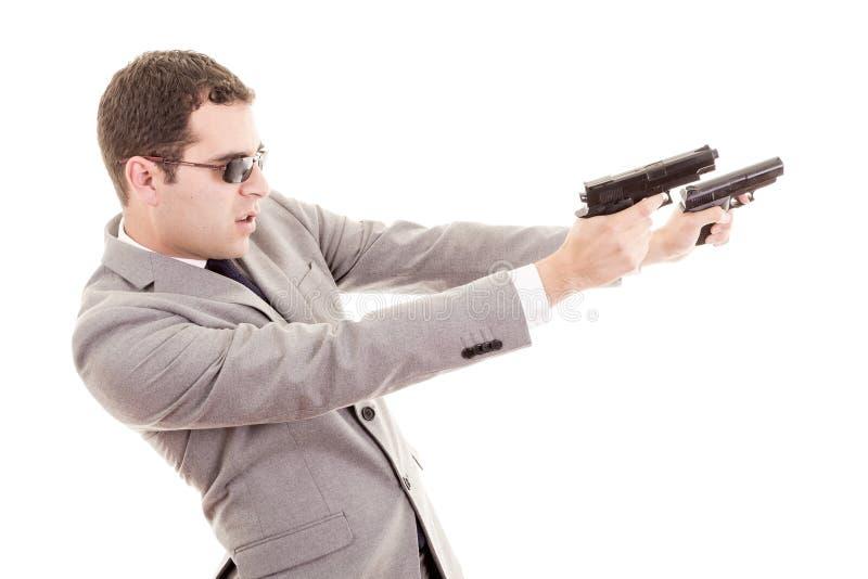 Hombre de negocios con el arma aislado en blanco imagen de archivo libre de regalías