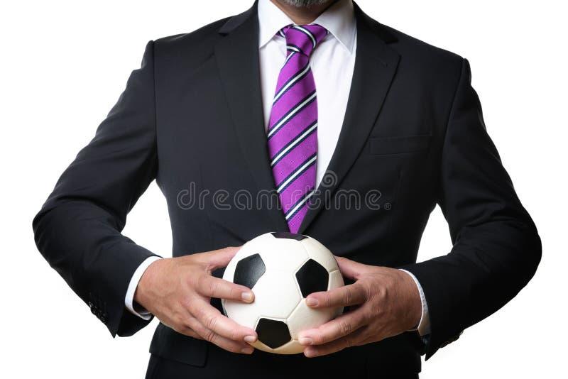 Hombre de negocios con el balón de fútbol foto de archivo libre de regalías