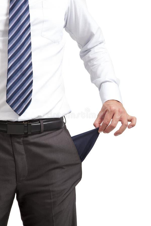 Hombre de negocios con el bolsillo vacío fotografía de archivo
