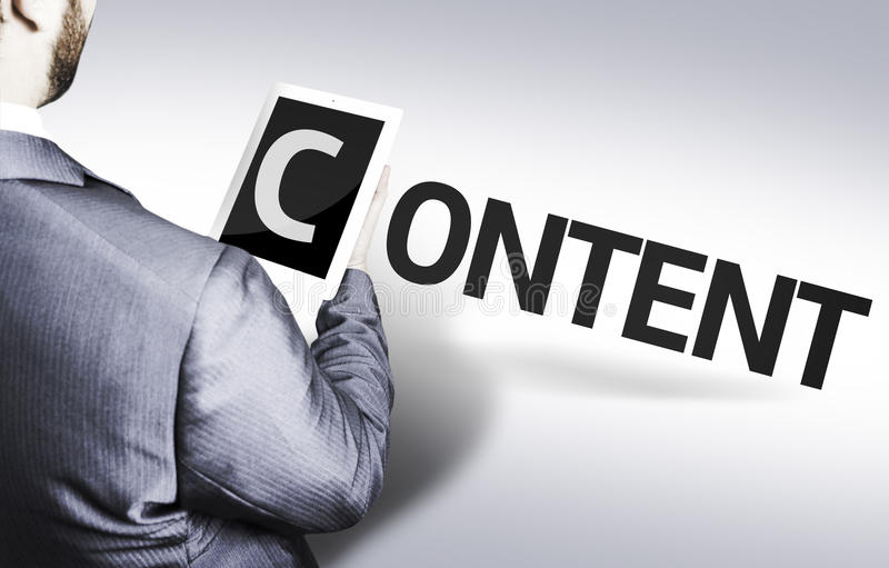 Hombre de negocios con el contenido del texto en una imagen del concepto fotos de archivo libres de regalías