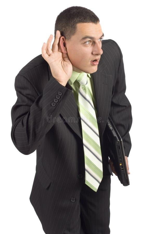 Hombre de negocios con el cuaderno - escuchando detras de las puertas fotos de archivo libres de regalías