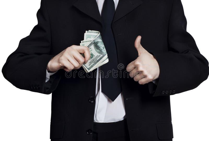 Hombre de negocios con el dinero que muestra a mano la muestra aceptable foto de archivo libre de regalías
