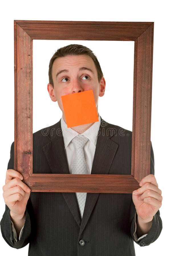 Hombre de negocios con el marco de madera fotografía de archivo libre de regalías