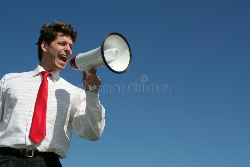Hombre de negocios con el megáfono imagen de archivo