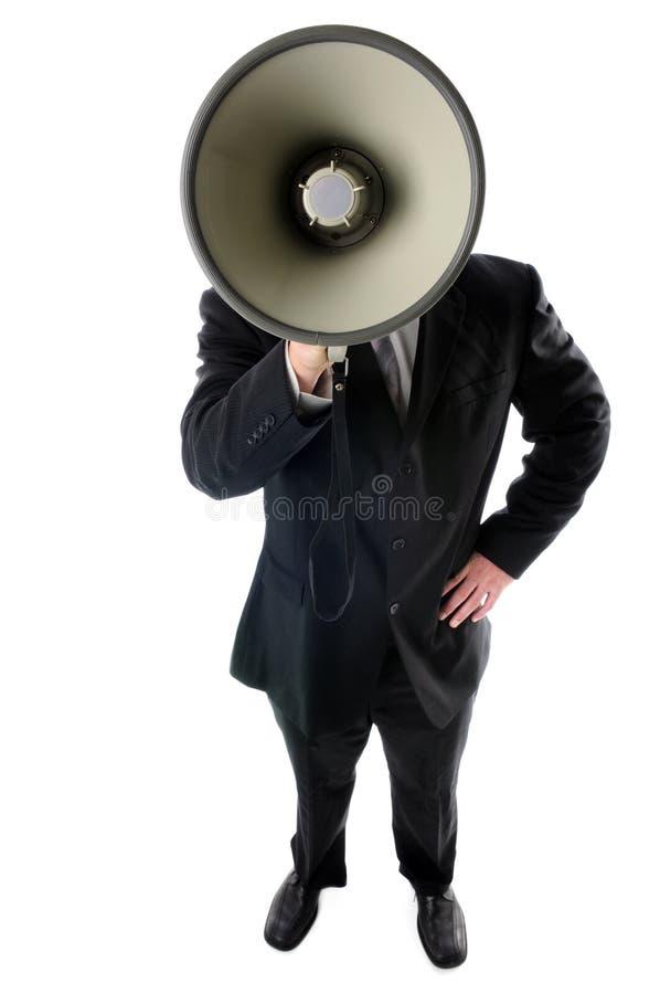 Hombre de negocios con el megáfono foto de archivo
