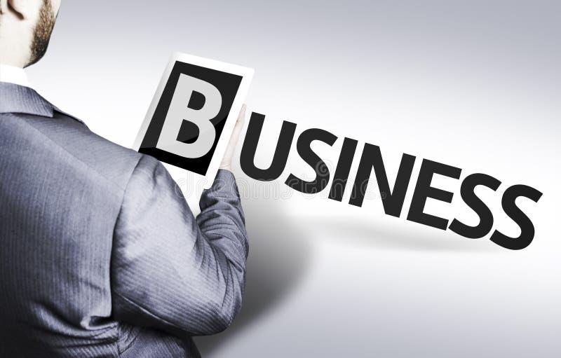 Hombre de negocios con el negocio del texto en una imagen del concepto foto de archivo