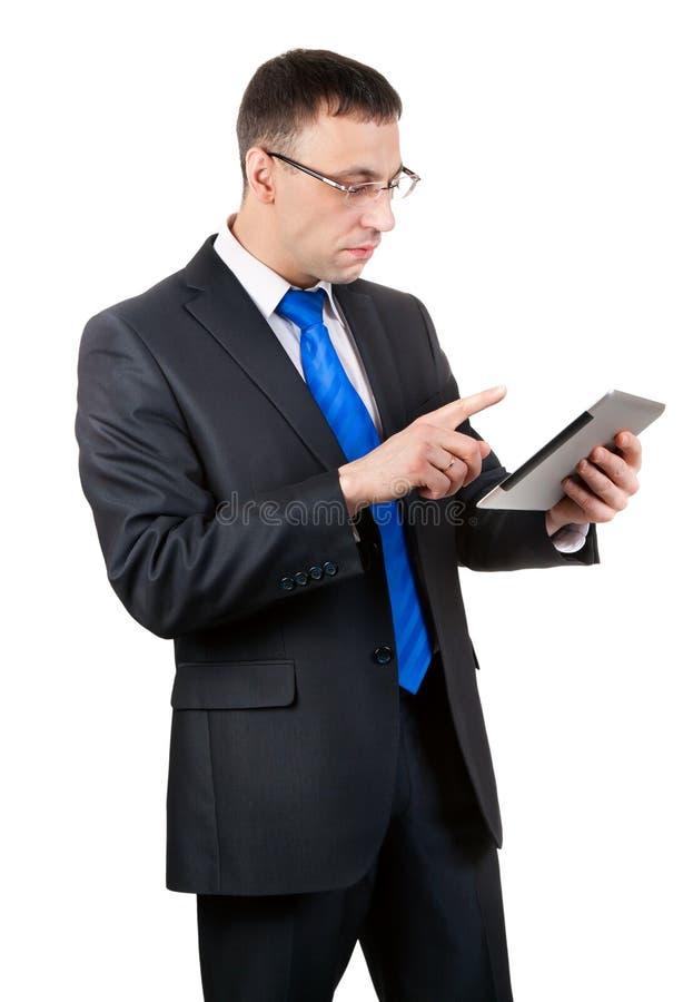 Hombre de negocios con el ordenador de la tablilla fotografía de archivo libre de regalías