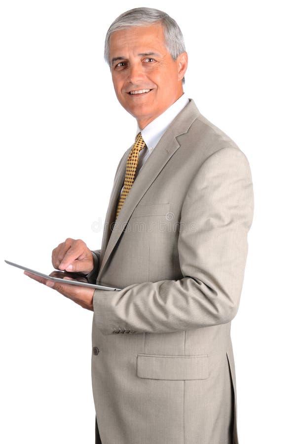 Hombre de negocios con el ordenador de la tablilla imagen de archivo libre de regalías