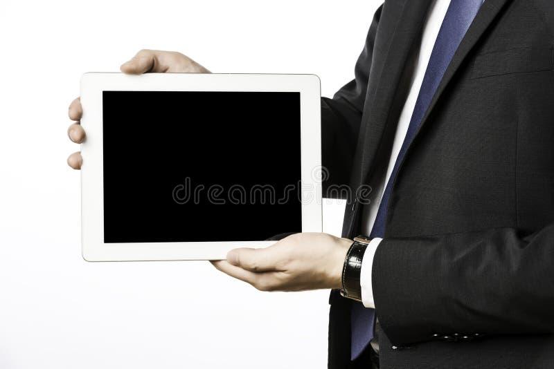 Hombre de negocios con el ordenador en blanco de la tableta imagen de archivo