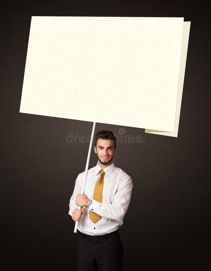 Hombre de negocios con el papel del post-it fotos de archivo