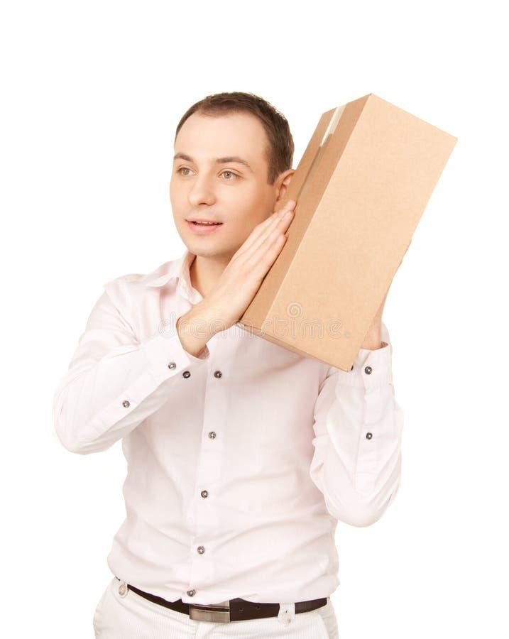 Hombre de negocios con el paquete imágenes de archivo libres de regalías