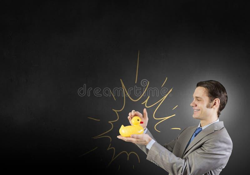 Hombre de negocios con el pato foto de archivo