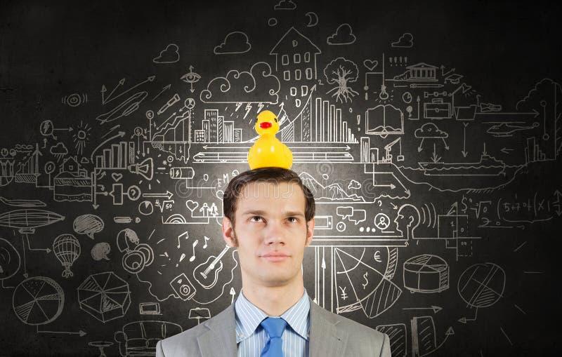 Hombre de negocios con el pato fotografía de archivo