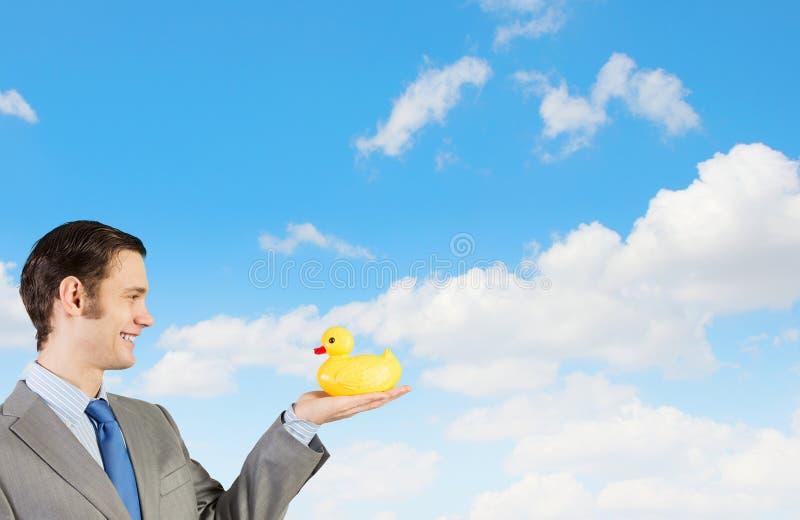 Hombre de negocios con el pato fotos de archivo