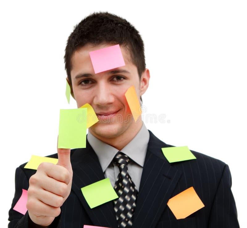 Hombre de negocios con el post-it colorido imagenes de archivo