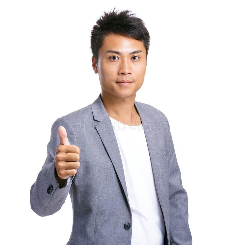Hombre de negocios con el pulgar para arriba foto de archivo