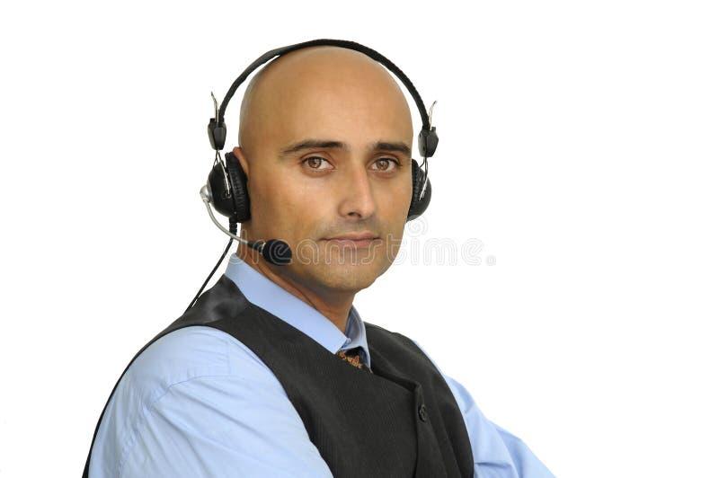 Hombre de negocios con el receptor de cabeza imagenes de archivo