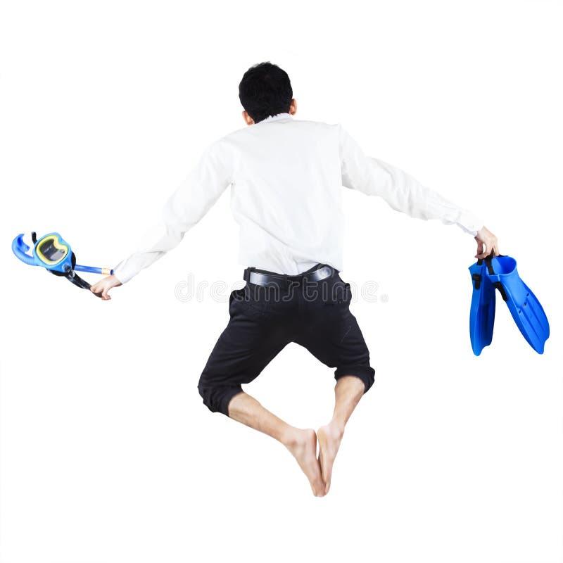 Hombre de negocios con el salto del engranaje que bucea imagenes de archivo