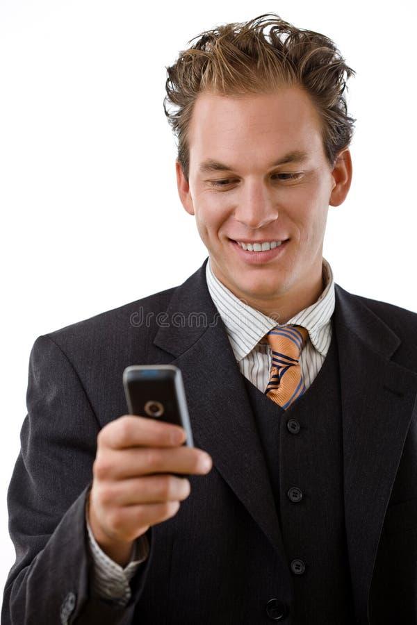 Hombre de negocios con el teléfono móvil imagen de archivo