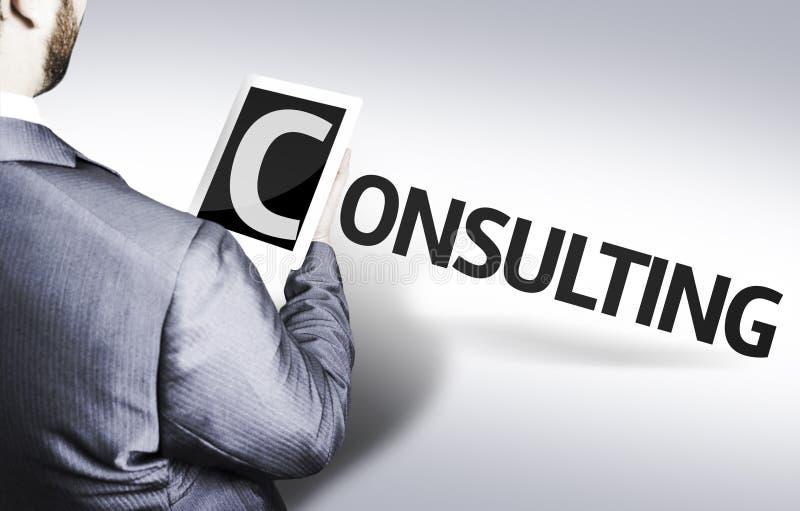 Hombre de negocios con el texto que consulta en una imagen del concepto fotos de archivo