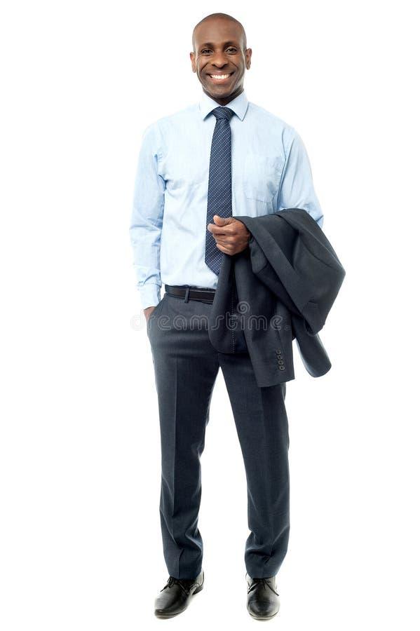 Hombre de negocios con el traje en su mano imágenes de archivo libres de regalías