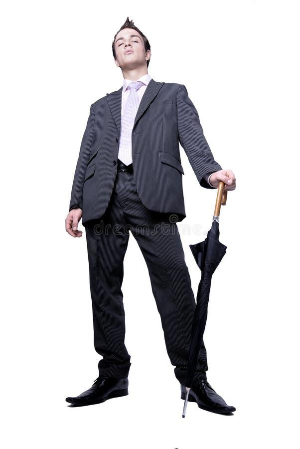 Hombre de negocios con estilo con el paraguas foto de archivo