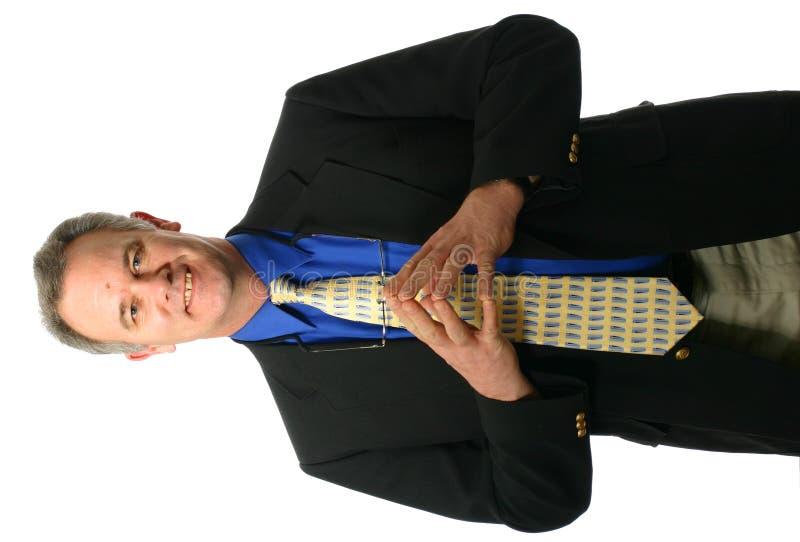 Hombre de negocios con gesto que da la bienvenida foto de archivo