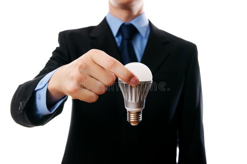 Hombre de negocios con la bombilla del LED fotografía de archivo