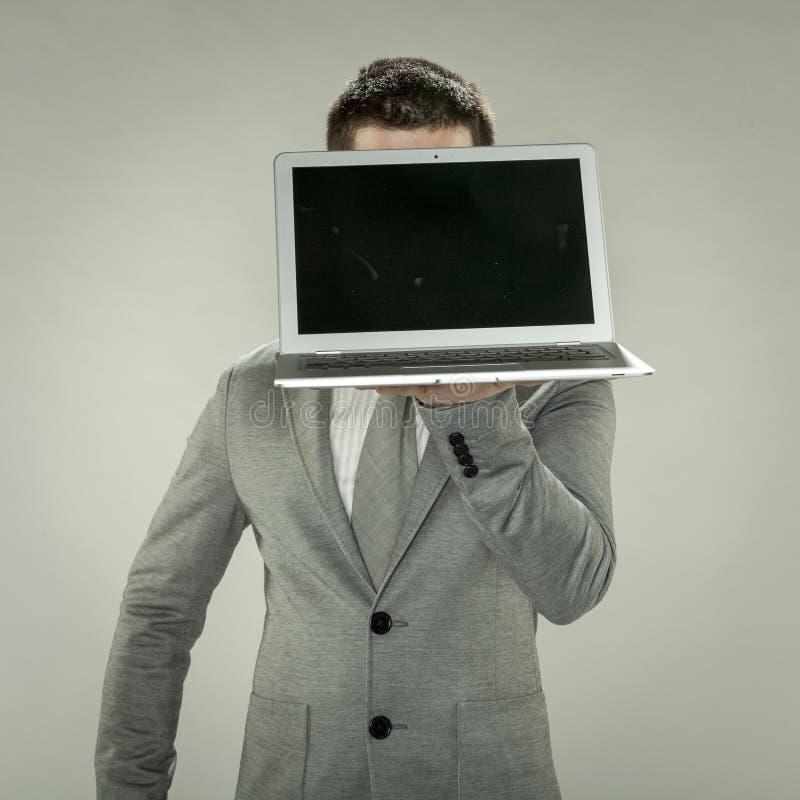 Hombre de negocios con la cabeza al comercio electrónico foto de archivo libre de regalías
