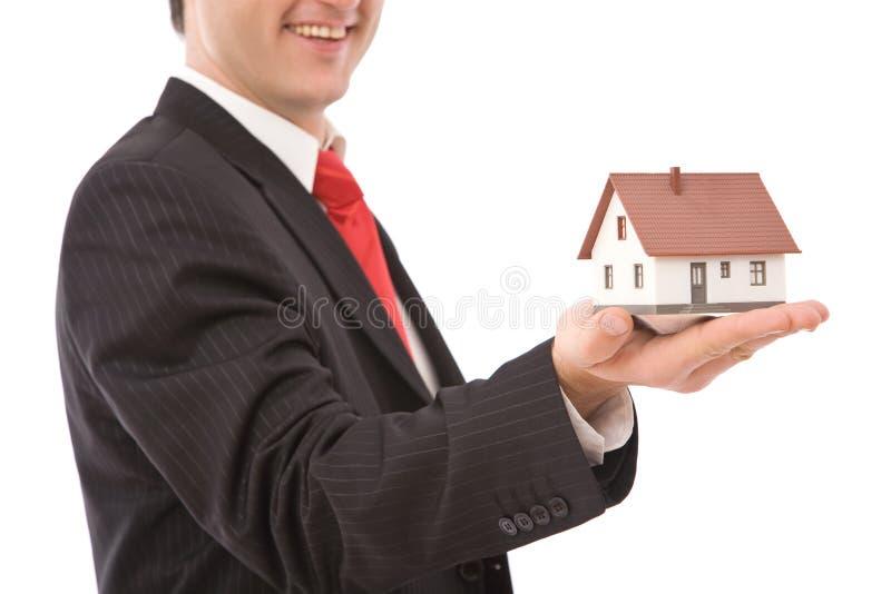 Hombre de negocios con la casa imagen de archivo libre de regalías